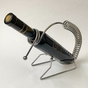 Unique metal wine bottle holder